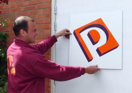 Belettering reclameborden Piet Putter
